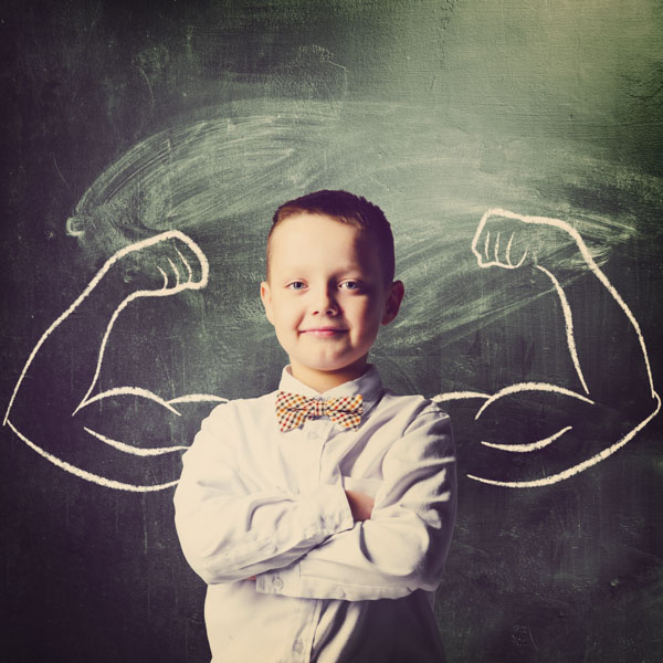 Little brainy boy with muscles drawn on chalkboard