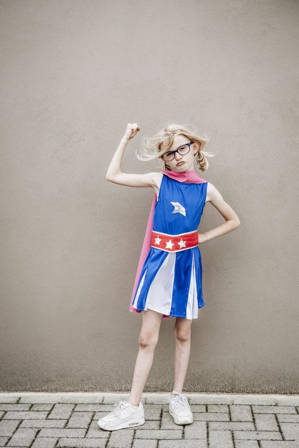 Girl with fierce determination in hero costume