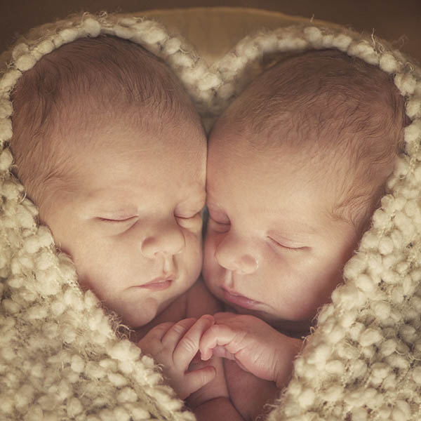 Darling twins wrapped in heart