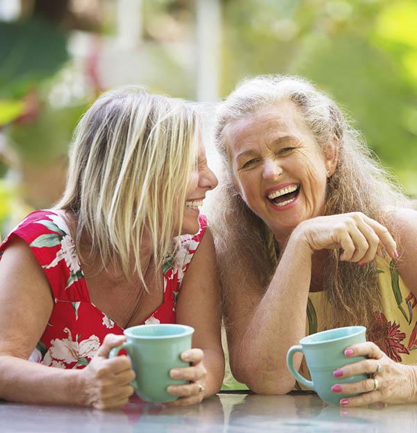 Beautiful 50 year old women friends laughing