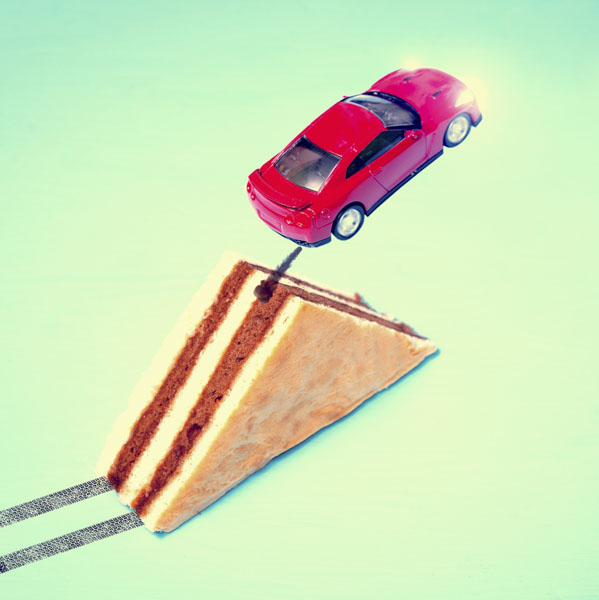 Car jumping from cake