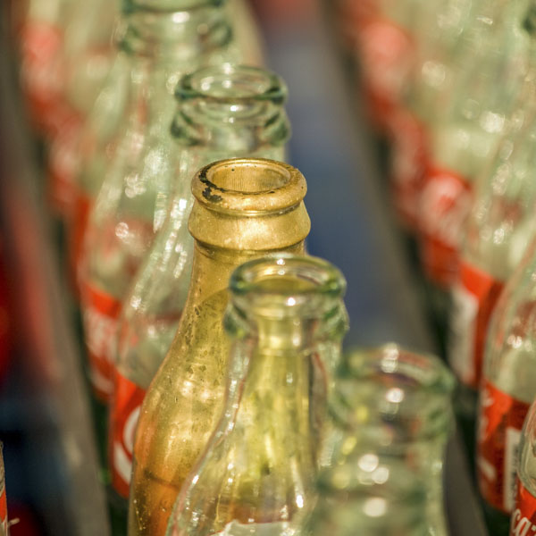 Soda bottles in row