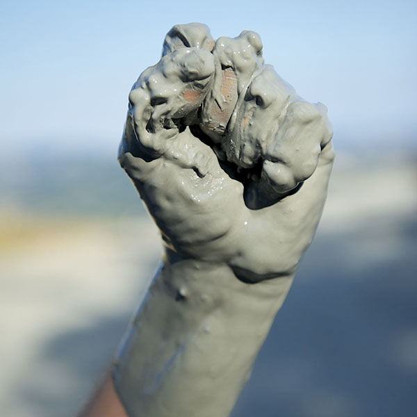 Hand covered in clay