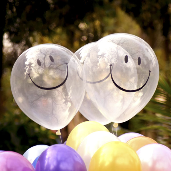 Iridescent balloons with smiles