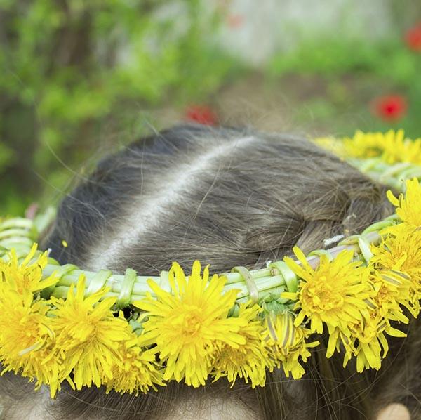 Little girl with summer flower wreath