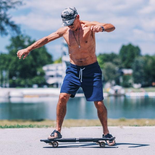 Mature man riding hover board