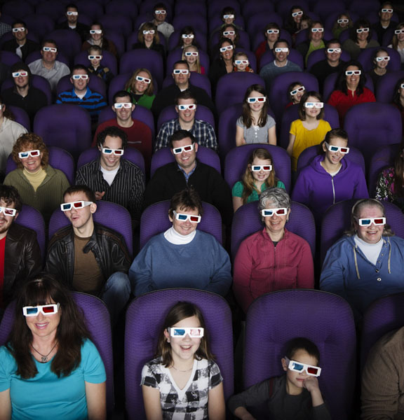 people in the cinema with 3D glasses