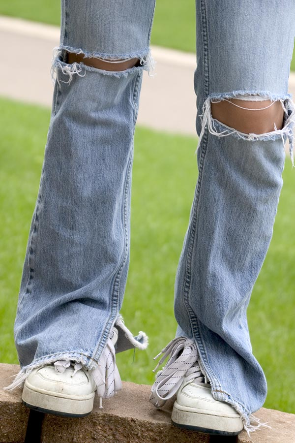 Girls' jeans with ripped knees
