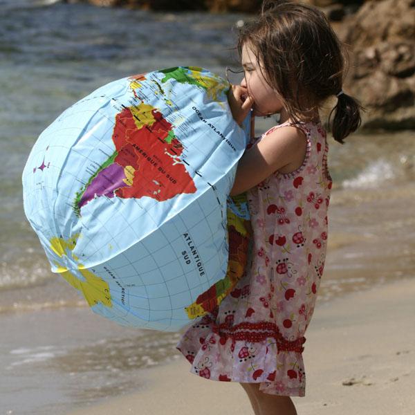 Little girl blowing up world floatie