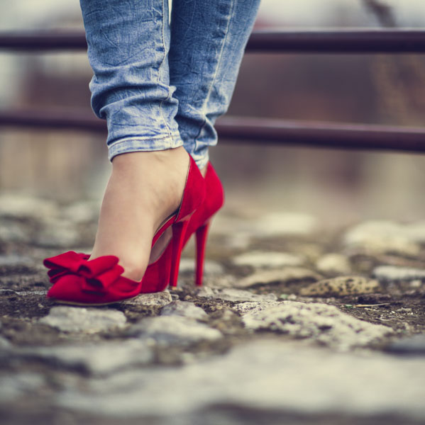 Dorothy in jeans and red high heels