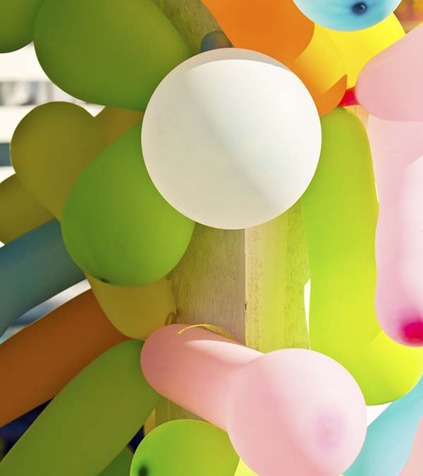Colorful balloons bouncing on post