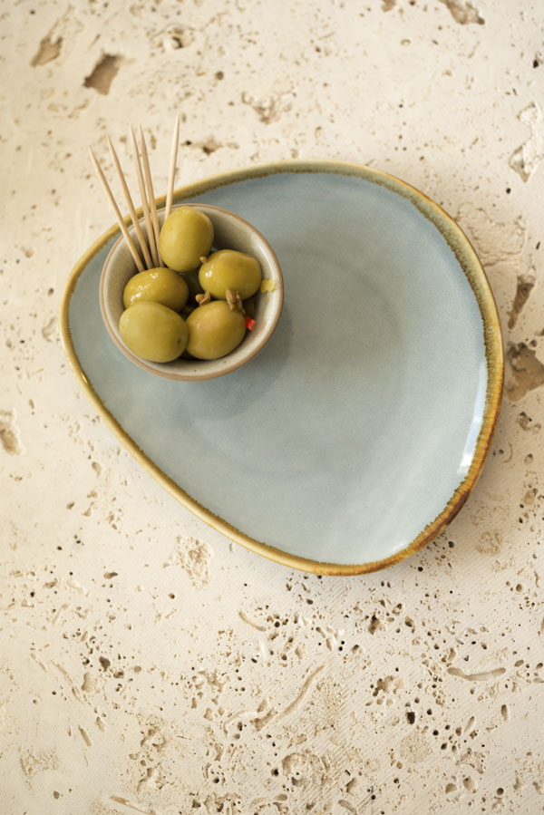 Olives in bowl on plate