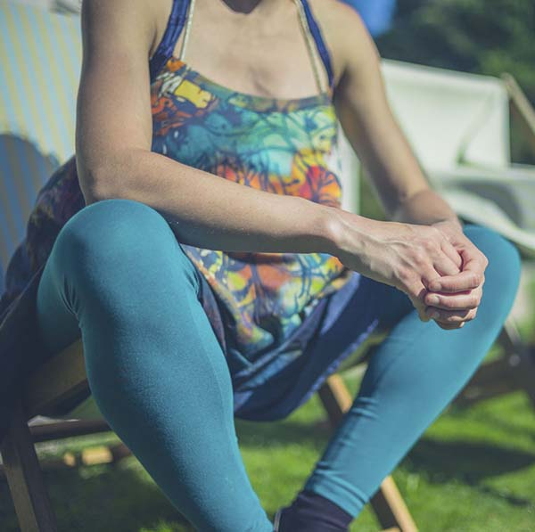Expectant mother in tie dyed top