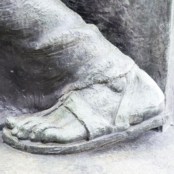 Close up of concrete foot on statue