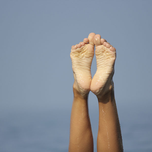 Pointed toes above the water in ocean