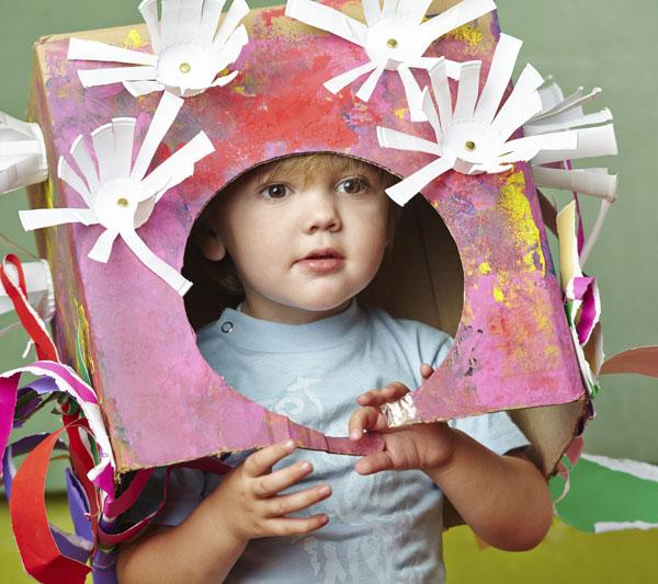 Little kid peeking out of cardboard box