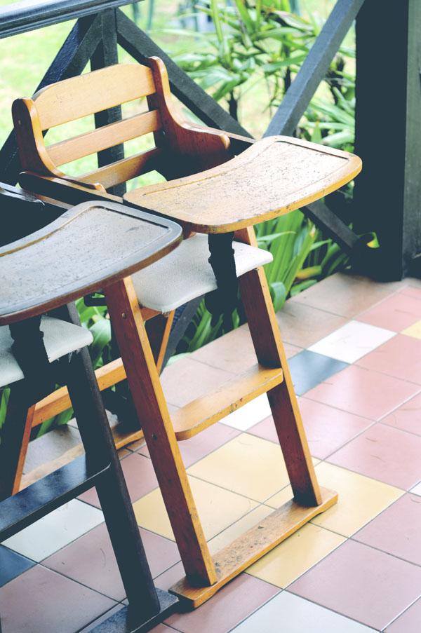 Wooden baby highchairs at restaurant