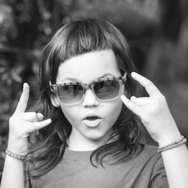 Girl showing rock on hands