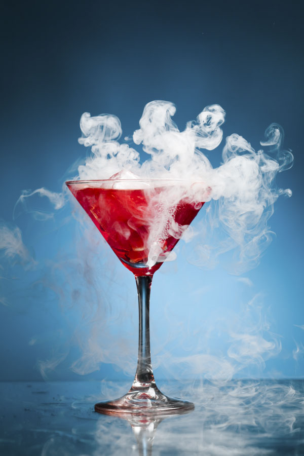 Bright red steamy cocktail drink
