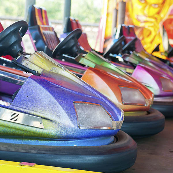 Colorful parked bumper cars at fair