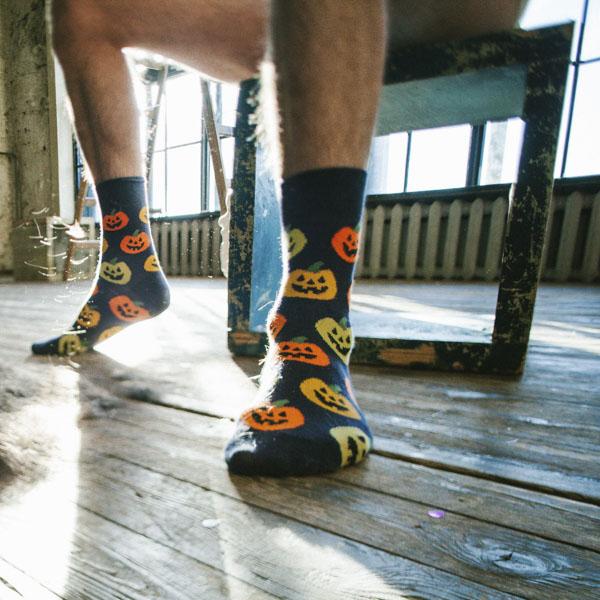 Man wearing Halloween pumpkin socks