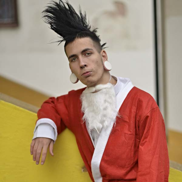Punk rocker in Santa suit