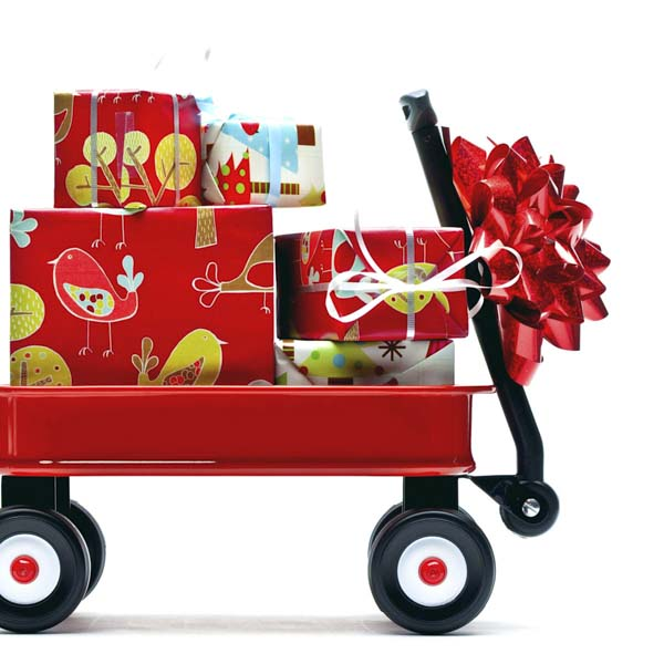 Christmas presents loaded in child's red wagon