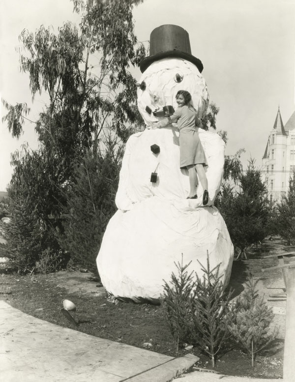 Giant paper mache snowman in summer