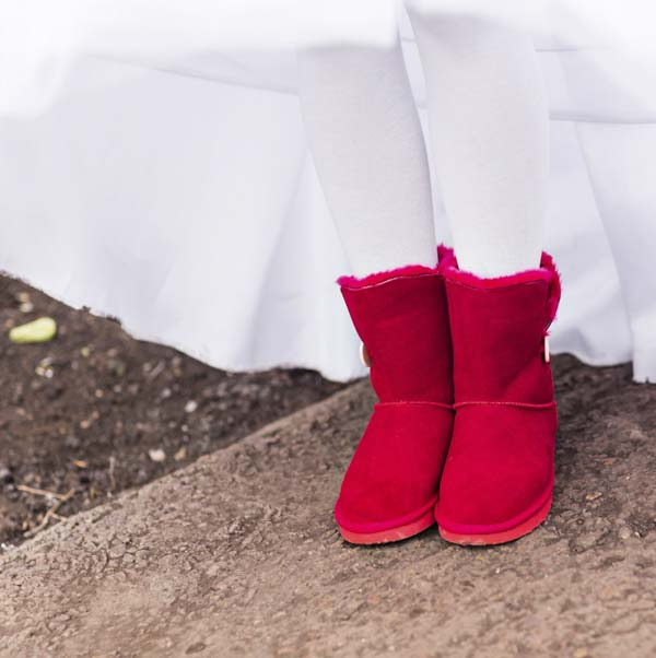 Woman in red Ugg boots