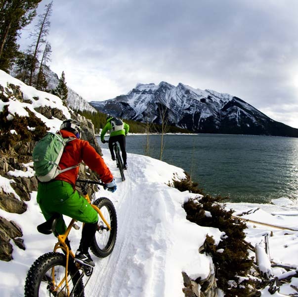 Man dressed as elf on mountain bikes in Lake Tahoe