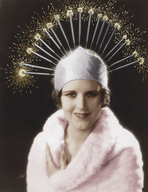 Woman wearing hat with sparklers