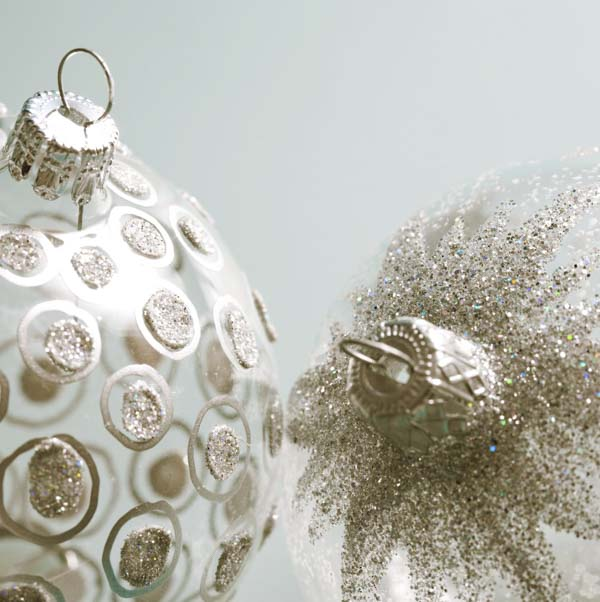 Two glitter ball Christmas ornaments with different patterns