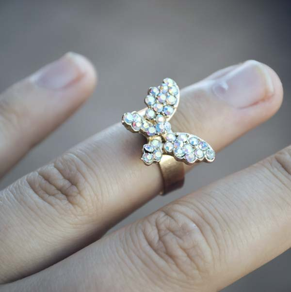 Rhinestone-covered butterfly ring on finger