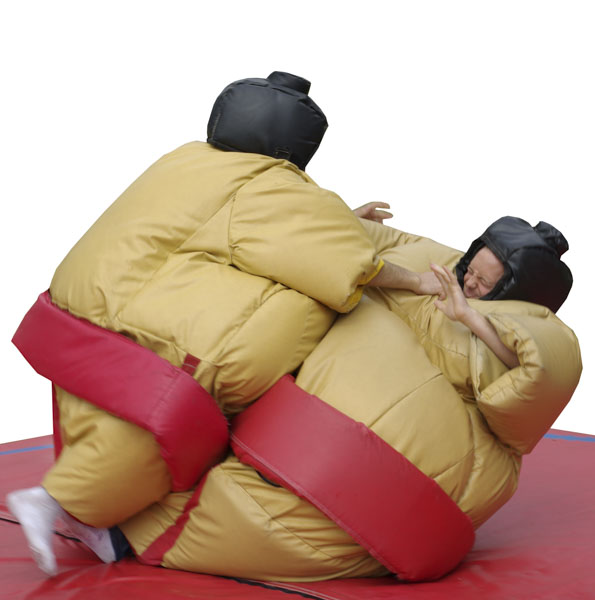 Two kids in inflatable sumo-wrestler costumes