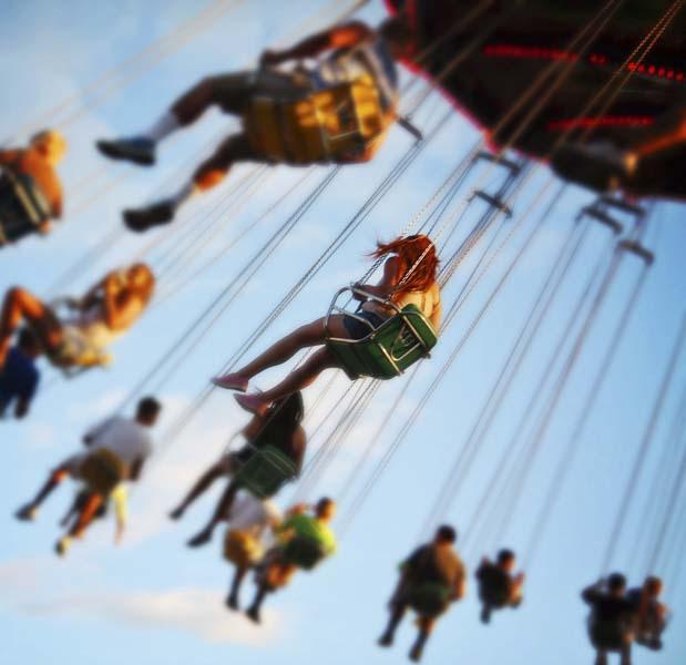 Kids on carnival swings