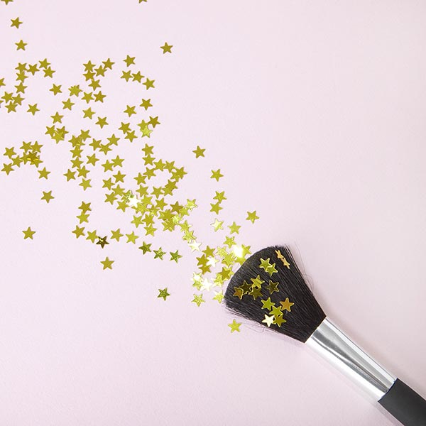 Make up brush and gold star glitter