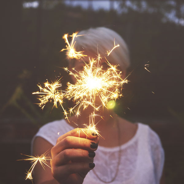 Woman holding up sparklers