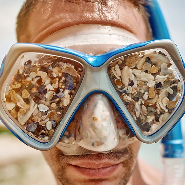 Snorkel mask filled with shells
