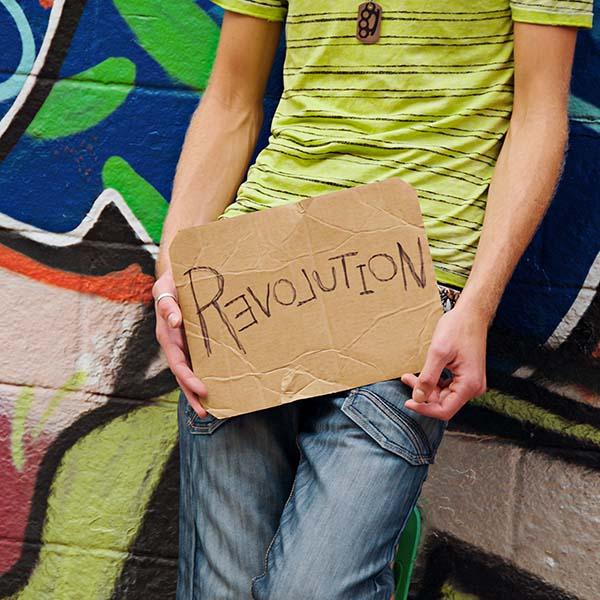 Man holding relovution sign