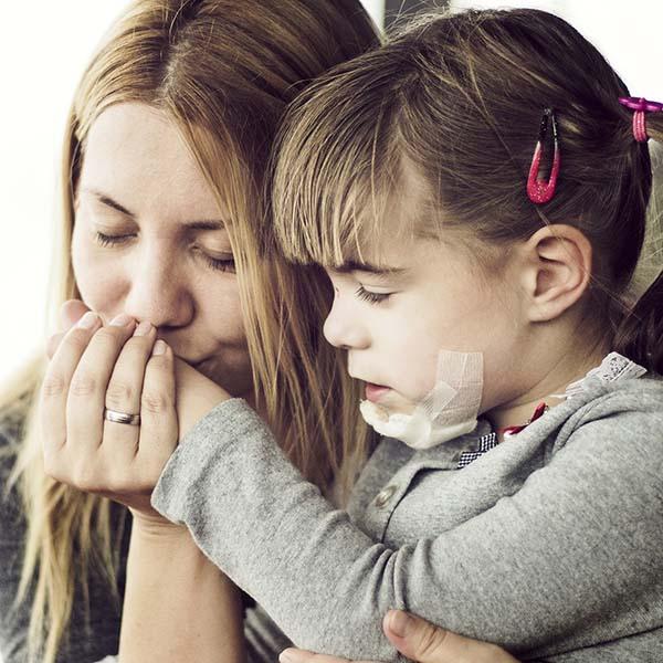 Mother comforting injured child