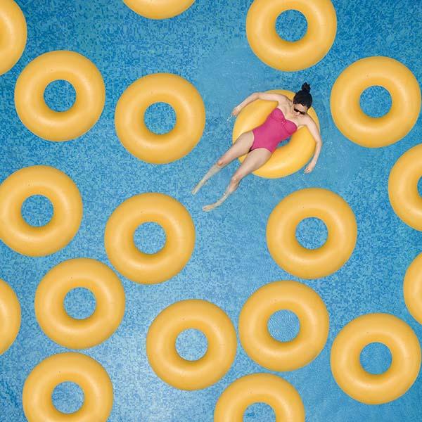 Woman on floatie in pool