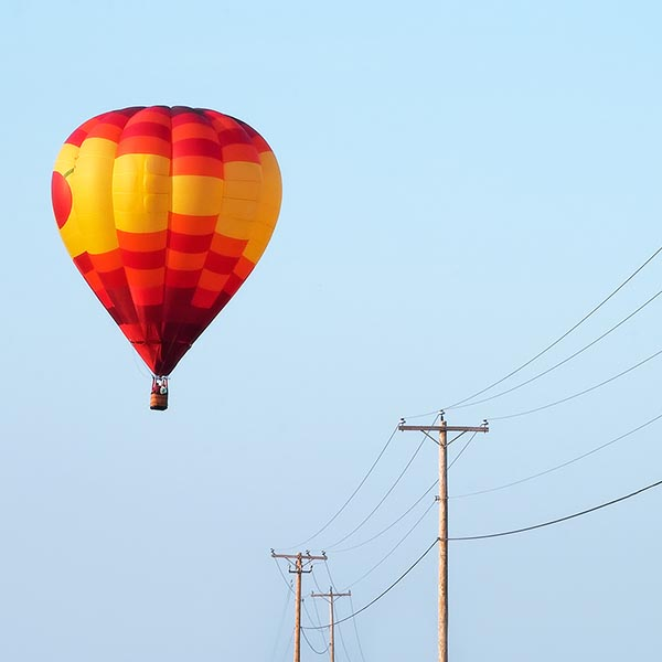 Hot air balloon heading for power lines