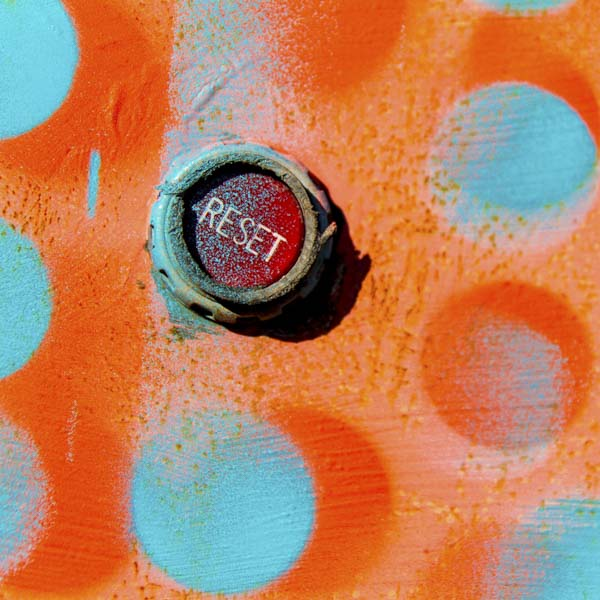 Reset button in a colored wall