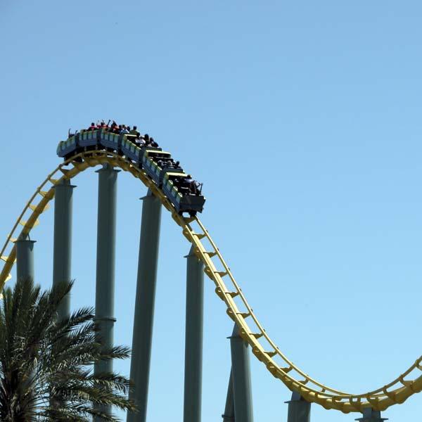 Roller coaster in a beautiful blue sky
