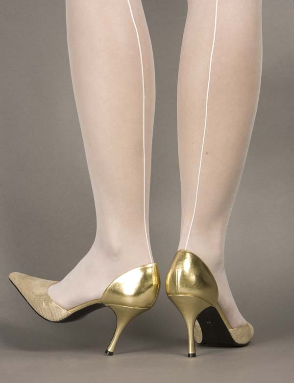 Woman with white transparent stockings in a gold high heels shoes