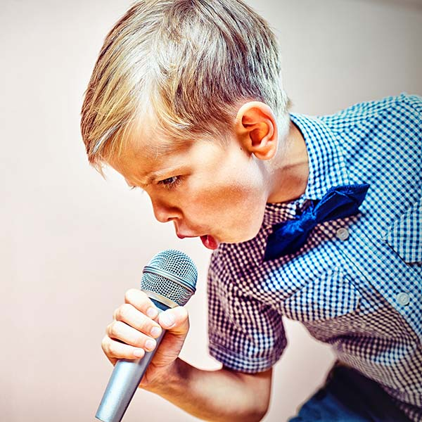 A child with a microphone in his hand