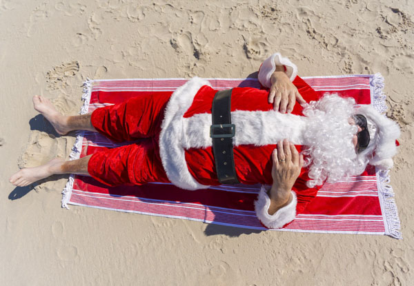 Father Christmas laying in the sun