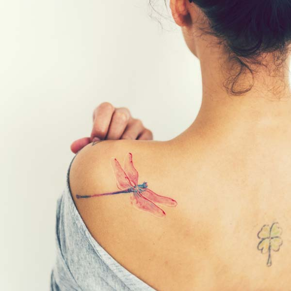 The back of a woman with a butterfly tatoo