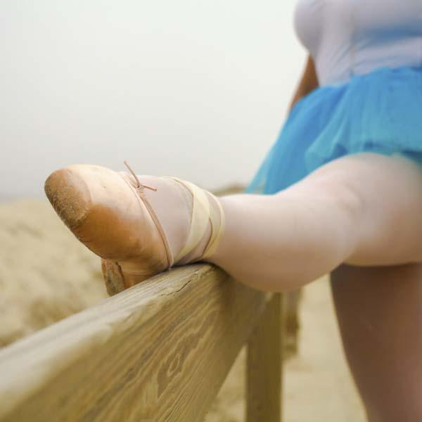 ballerina foot raised at a bench