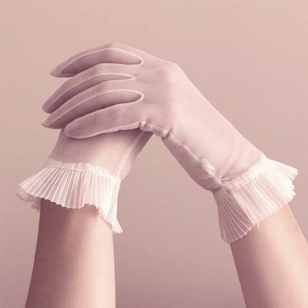 Two hands with gloves touching each other